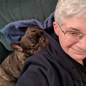 French Bulldog leaning on woman
