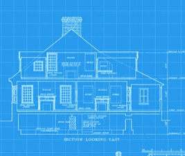 Photo of a house blueprint, showing that responsible dog breeding is like following building code.