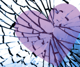 Picture of sadness - heart behind broken glass